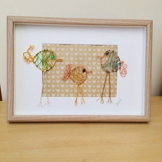 Framed picture of three wire birds