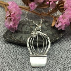 Large round cactus with flower in a pot pendant suspended from a bail and silver trace chain