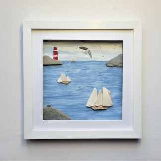 framed picture featuring tall ships created from sea pottery