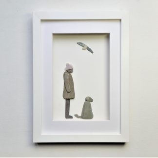 Pebble art framed picture featuring a lady and her dog