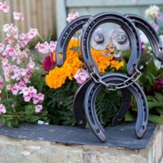 Handcrafted Dog made from horseshoes in garden