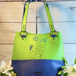 Full view of lime and blue faux leather handbag