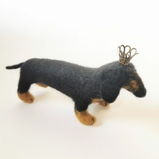 standing black daschund ornament wearing a crown