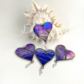 Blue stained glass heart with seahorse charm