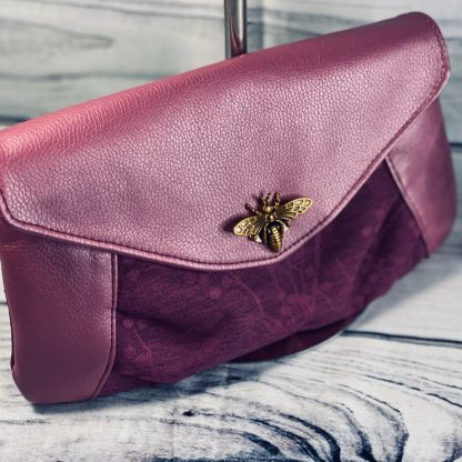 Gorgeous pink clutch bag in faux leather and deep pink brocade. Perfect for an evening out or to go with your wedding outfit.