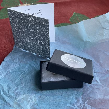 Product shown with gift message and tissue paper