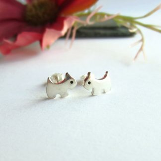 A pair of cute, handmade, fine silver tiny terrier dog stud earrings, handcrafted by The Tiny Tree Frog Jewellery