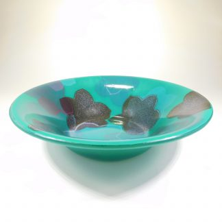 Large round fused glass bowl with a Hellebore pattern