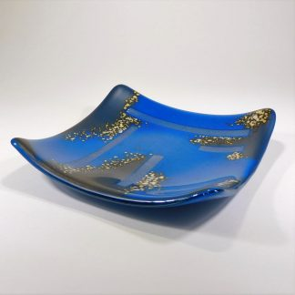 Prussian blue fused glass dish with design accents of silvery grey and sparkling iridescent glass strips