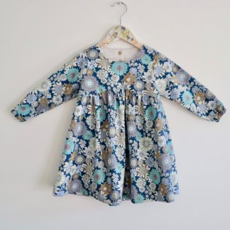 Girls Long Sleeved Gathered Dress in A Vintage Style Blue Sunflowers Print