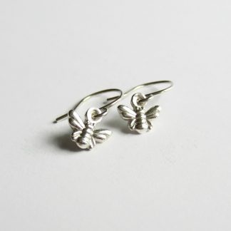 A pair of cute little handmade, fine silver bumble bee drop earrings, handcrafted by The Tiny Tree Frog Jewellery