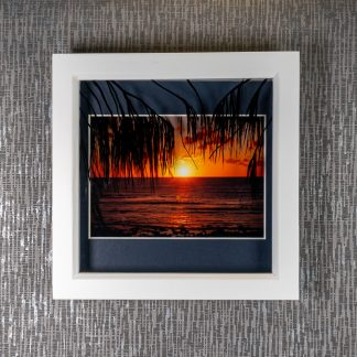 Hand painted palm frond silhouettes casting 3D shadows over a beach sunrise photograph, framed picture by Pictures2Mixtures