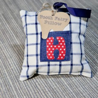 Tooth Fairy Pillow in a Cream & Navy Check Fabric with A Letter H on a small denim pocket on the front & ribbon hanging loop