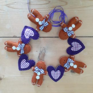 Purple and white gingham hearts and Gingerbread men garland