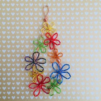 Teardrop shape wire wreath with brightly coloured flowers made using glass tubular beads of differing colours