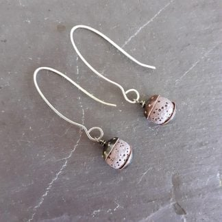 Acorn style earrings with mauve colour lava rock beads and recycled copper