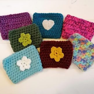 crocheted coffee cosy flowers and hearts