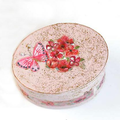 Small pink oval gift box decorated with red flowers and butterfly on lid