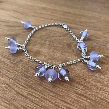Sterling silver bracelet with handmade lilac lampwork beads