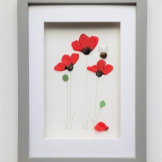 framed picture of red poppies created from nuggets of Cornish sea glass