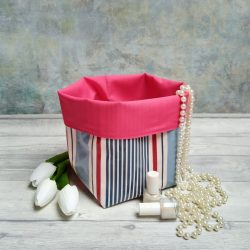 blue and red nautical stripe storage basket with vibrant pink lining
