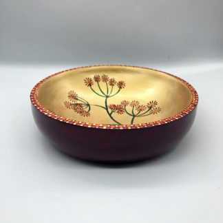 Pink and gold dish with seed head design and dotted edge