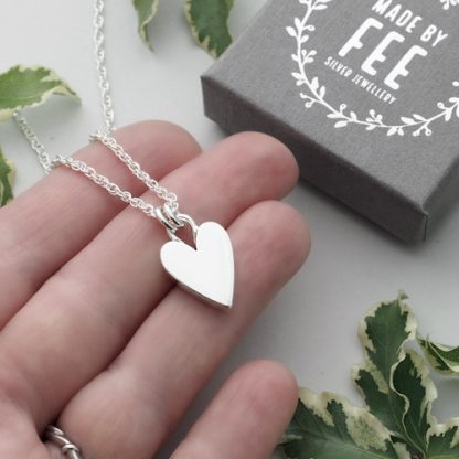 handmade solid sterling silver chunky heart pendant necklace on a rope chain shown on hand