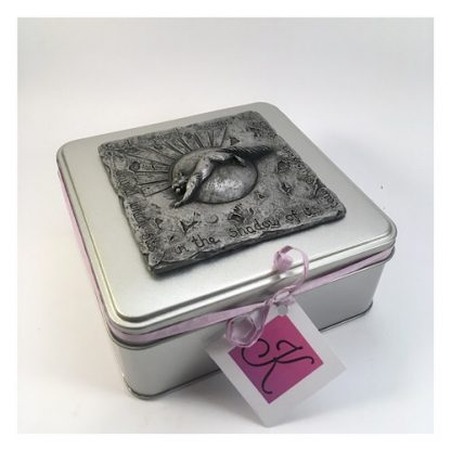 Square tin with a red squirrel design on the lid in Pewter relief