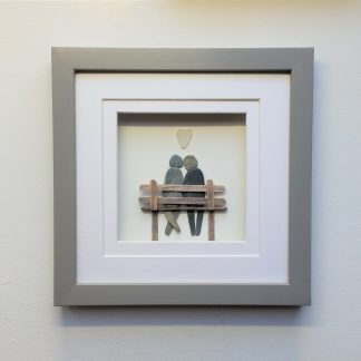 framed picture of pebble couple on bench