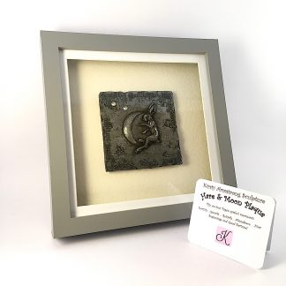 Handmade Pewter Plaque showing a stylised Hare and Moon mounted in a grey box frame
