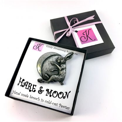 A handmade Pewter Hare and Moon brooch in a decorated gift box