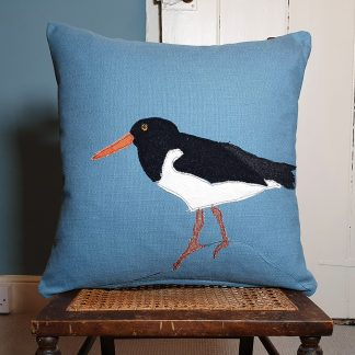 Appliqued Oystercatcher on blue cotton cushion cover
