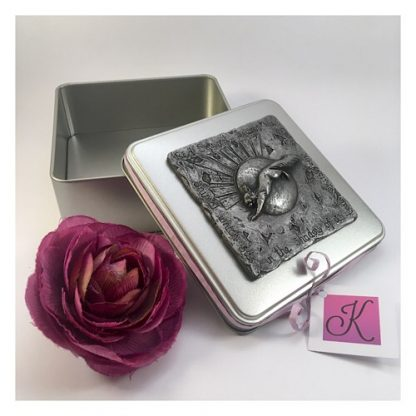 Square tin with a red squirrel design in pewter on the lid