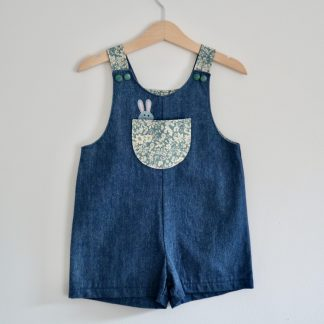 Denim toddler sized shorts romper with floral bib pocket & a little mouse peeking over the top