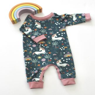 Baby footless all in one in navy blue and pink unicorn print