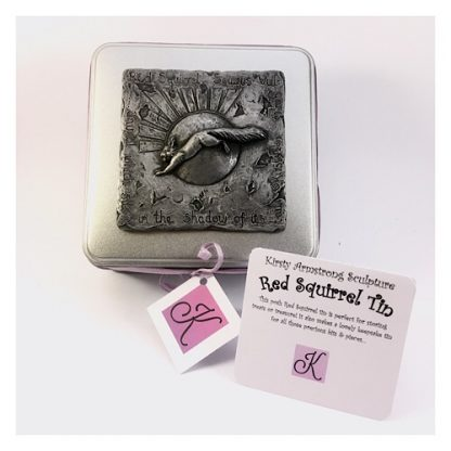 Top view of a square tin with a red squirrel plaque on the lid in pewter relief