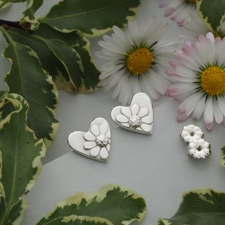 Handmade heart shaped fine silver stud earrings with half daisy in relief sterling silver posts