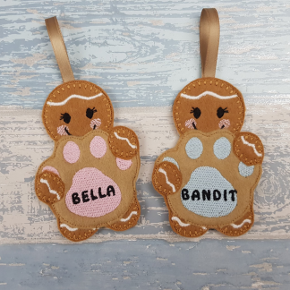 Gingerbread Holding a Personalised Dog Paw Print with Baby Pink or Blue Stitching