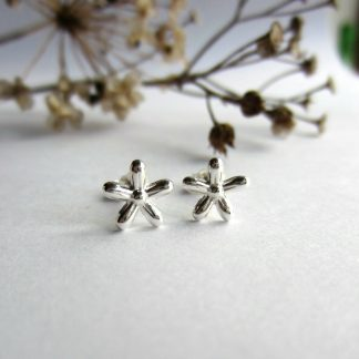 A pair of pretty, handmade, fine silver flower stud earrings, handcrafted by The Tiny Tree Frog Jewellery