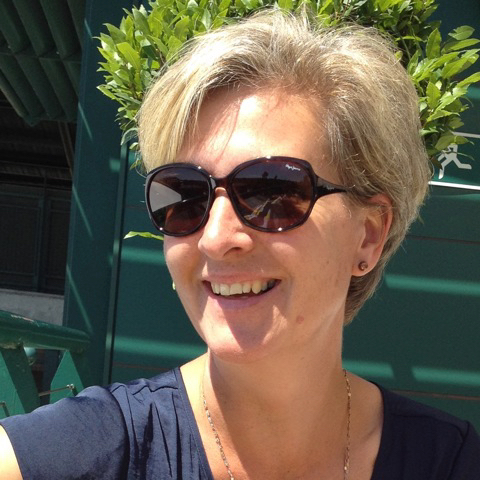 Picture of Liz, white female with short hair wearing sunglasses and smiling