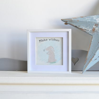 Original art by LouLou & Reg of a hare with a dandelion and the words make wishes