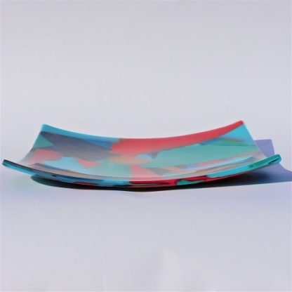 Side view of a square multicoloured fused glass platter