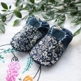 Baby slippers with navy floral uppers & denim heels. Lined in a pale blue spotty fabric