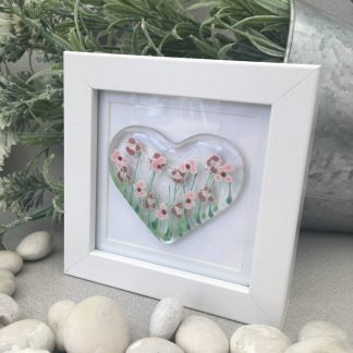 Fused glass pink daisy heart, clear glass and hand painted, and mounted in a deep square frame