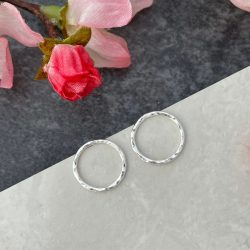Front facing hoop silver circle earring hammered studs