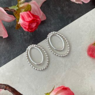 Silver oval front facing hoops stud earrings