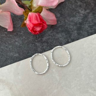 Small silver front facing hoop oval earring hammered studs