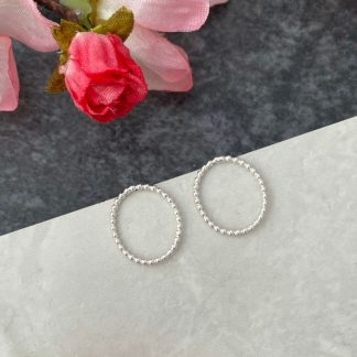 Silver oval front facing hoopsmall stud earrings
