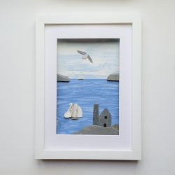 framed picture of a cornish tin mine engine house created from stone and sea shells