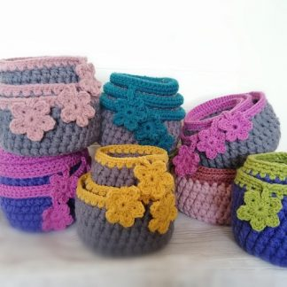 crocheted storage baskets various colours